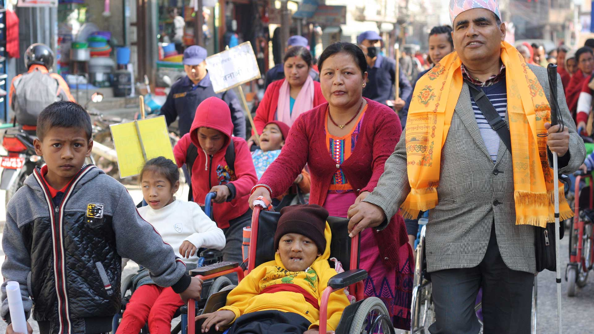 Carers and disabled adults and children as part of a parade in Nepal