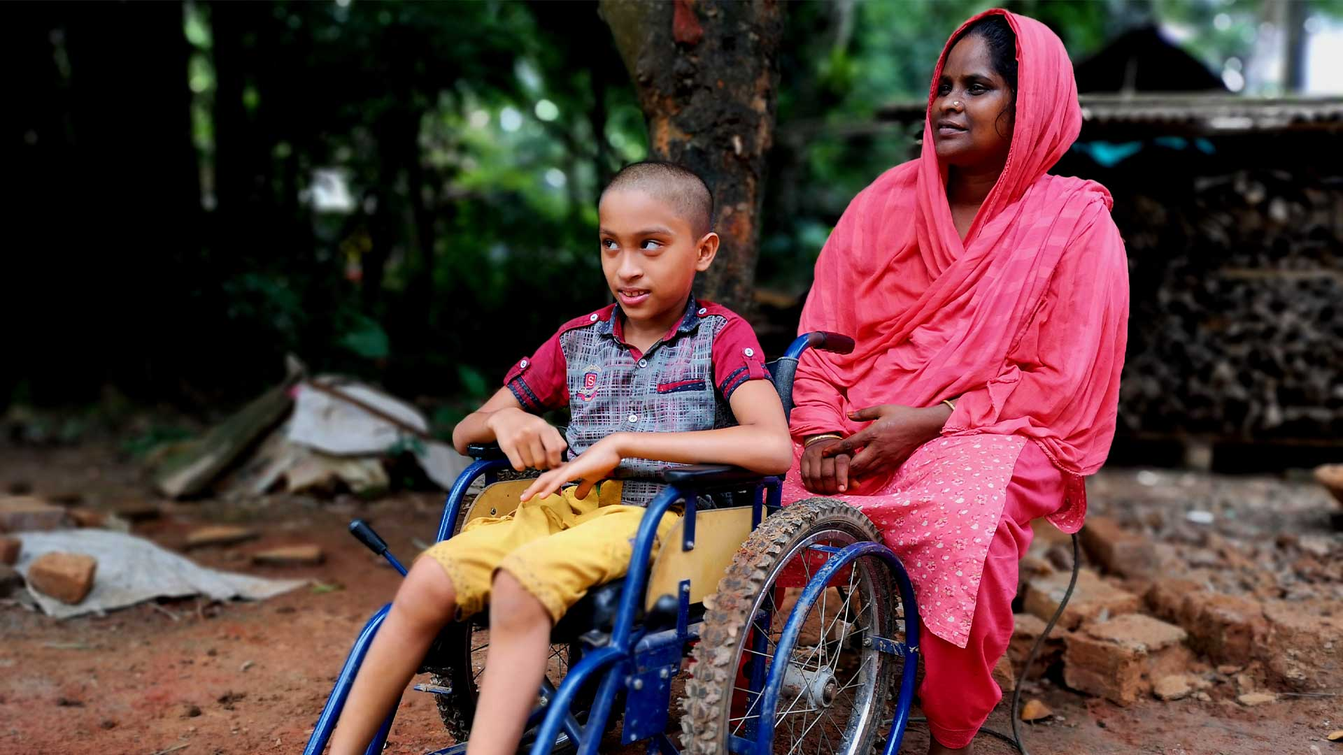 Carer with her son in wheelchair