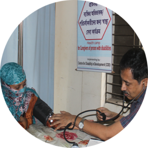 Doctor conducting health check on female carer in Bangladesh