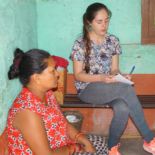 Victoria conducting research with female carer and Padam from LEADS Nepal
