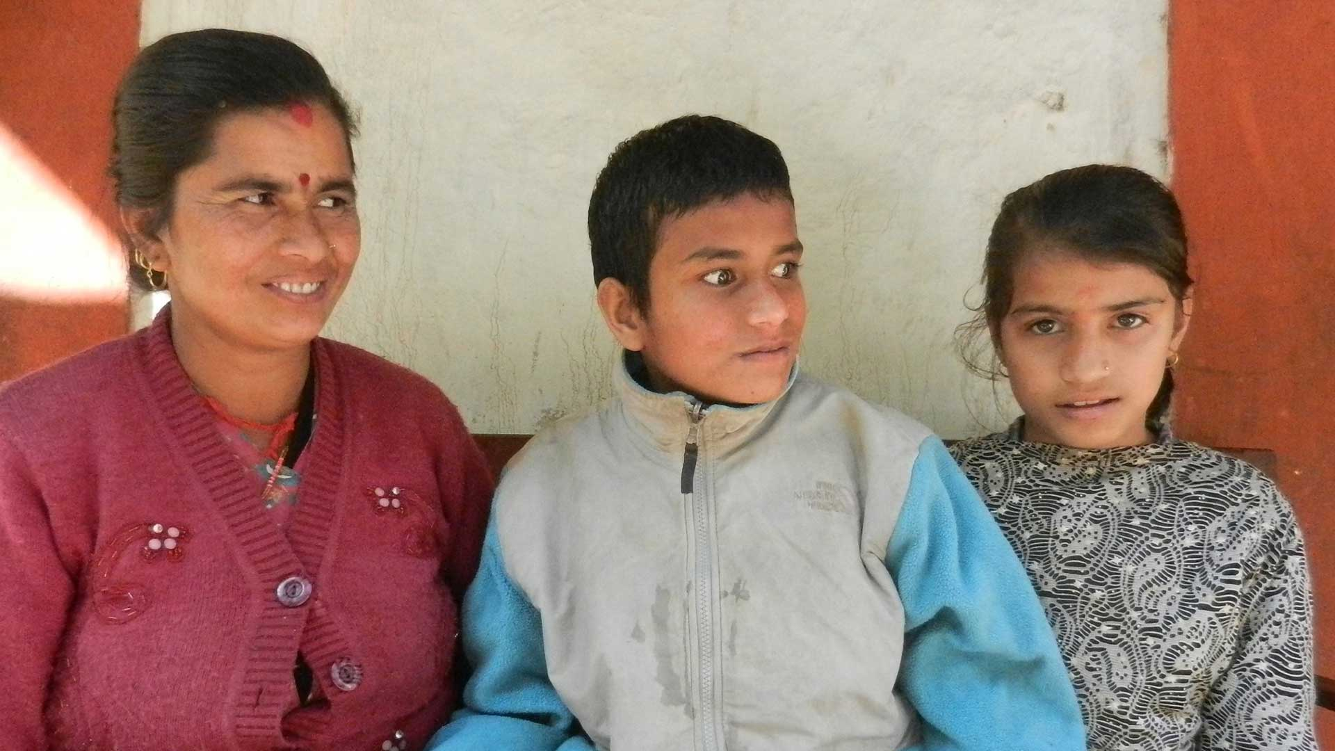 Female carer with her son and daughter in Nepal