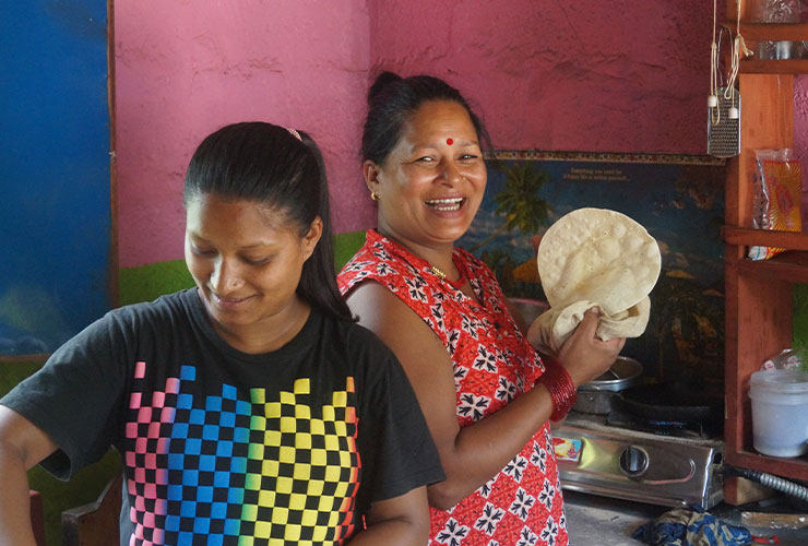 Carer Jag and her daughter cooking