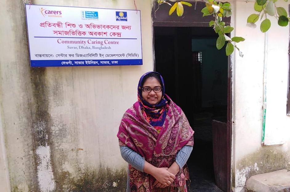 Farah stood outside Community Caring Centre