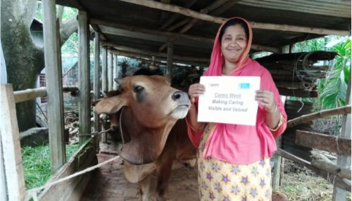 Woman standing outdoors next to a cow