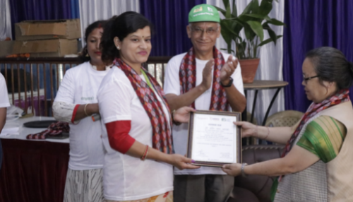 Woman accepting a certificate