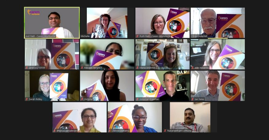 Image of staff and trustees on a zoom call, all holding up a copy of the Impact Report
