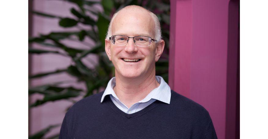 Image of a man smiling at the camera